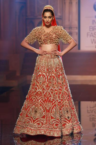 New Delhi: Actress Sonam Kapoor walks the ramp displaying a bridal outfit from the latest collection of Indian designers Abu Jani and Sandeep Khosla, during the BMW India Bridal Fashion Week, in New Delhi, on Aug 7, 2015. (Photo: Amlan Paliwal/IANS)