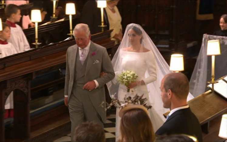 Prince Charles escorts the bride down the aisle of St. George's Church